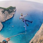 Rope jumpers caught free falling for six seconds before landing safely on paradise beach